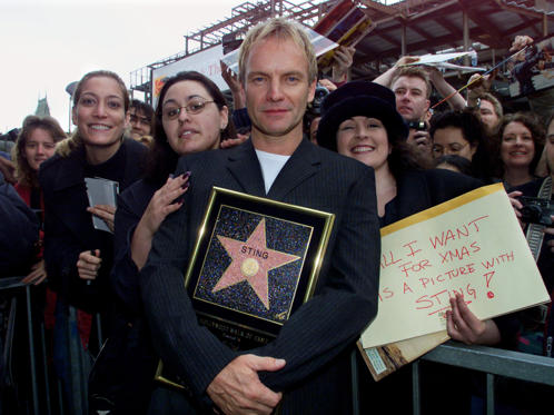 "British rock star Sting poses with fans following ceremonies to honor him with a star on the Hollywood Walk of Fame during ceremonies in his honor December 8, 2000 in Hollywood. Sting, who wrote the songs for the new Walt Disney Pictures animated feature ""The Emporer's New Groove"" has also received 14 Grammy Awards."