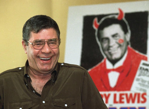 Entertainer Jerry Lewis laughs as he fields questions from the media at the Ritz-Carlton Hotel in Pasadena, Calif., Nov. 28, 1995. Lewis is starring in the nationally touring production of the Broadway musical ?Damn Yankees,? which comes to the Pasadena Civic Auditorium for eight performances starting on November 28.