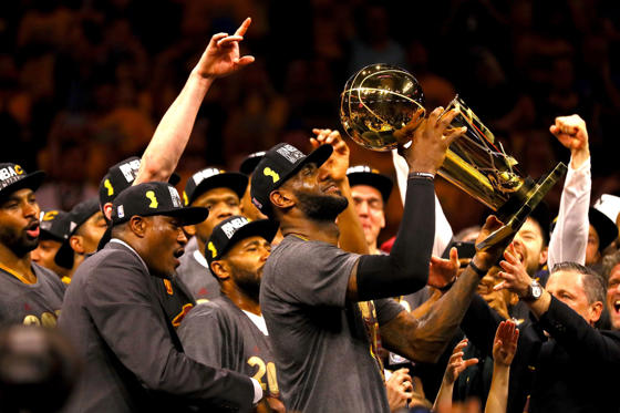 OAKLAND, CA - JUNE 19:  LeBron James #23 of the Cleveland Cavaliers holds the Larry O'Brien Championship Trophy after defeating the Golden State Warriors 93-89 in Game 7 of the 2016 NBA Finals at ORACLE Arena on June 19, 2016 in Oakland, California. NOTE