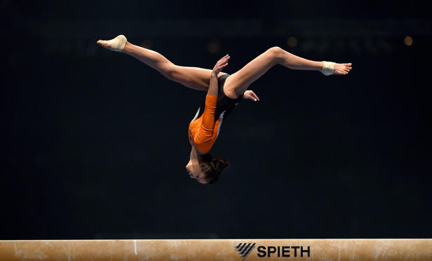 KARLSRUHE, GERMANY - DECEMBER 05:  Isabelle Stingl of TG Karlsruhe Soellingen competes on the Beam during the Women's DTL Finals 2015 at Messehalle 2 on December 5, 2015 in Karlsruhe, Germany.  (Photo by Matthias Hangst/Bongarts/Getty Images)