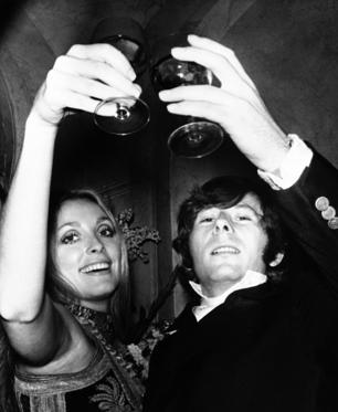 "FILE - In this Feb. 18, 1969 file photo, Roman Polanski is shown with his wife, the actress Sharon Tate, toasting the opening of ""Rosemary's Baby"" in London. A topless photo of Polanski and Tate, taken just months before her death has sold at a New York City auction for $11,250. Christie's says it was sold Monday Dec. 7, 2009 to an unidentified private buyer."