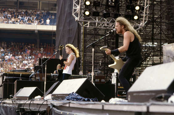 "Bassist Jason Newsted and Singer and guitarist James Hetfield of the heavy metal quartet ""Metallica"" perform onstage at the ""Monsters of Rock"" festival at Rice Stadium on July 2, 1988 in Houston, Texas."