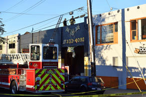 Firefighters assess the scene where a fire tore through a warehouse party early Saturday, Dec. 3, 2016 in Oakland. The blaze began at about 11:30 p.m. on Friday during a party at a warehouse in the San Francisco Bay Area city. Several people are unaccounted for.