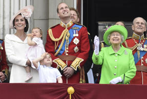 Members of the royal family, including Catherine, Duchess of Cambridge holding P...