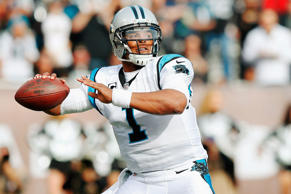 Cam Newton #1 of the Carolina Panthers looks to pass in the first quarter against the Oakland Raiders on Nov. 27, in Oakland, Calif.