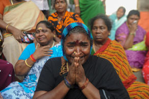 Supporters of Tamil Nadu state leader Jayalalithaa Jayaram cry in front of a hospital where she was being treated in Chennai on December 5, 2016. The ailing chief minister of southern India's Tamil Nadu state, Jayalalithaa Jayaram, has suffered a cardiac