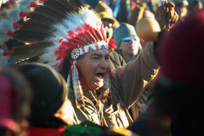 Native American activists celebrate after learning an easement had been denied f...