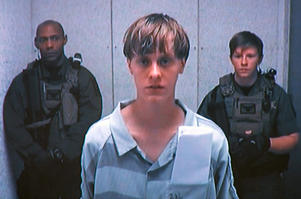 Dylann Storm Roof appears by closed-circuit television at his bond hearing in Charleston, South Carolina, U.S. June 19, 2015 in a still image from video.  REUTERS/POOL/File Photo