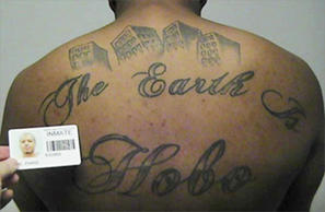 "Photo of Paris Poe's back tattoo that reads ""The Earth Is Our Turf"", and Hobo. Poe is one of six defendants on trial for racketeering and other charges are purported leaders of the widely feared Hobos, a South Side gang."