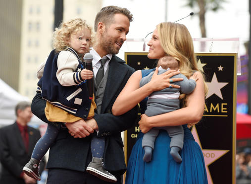Slide 1 of 35: Actor Ryan Reynolds poses with his wife, actress Blake Lively, their daughter James, left, and their youngest daughter during a ceremony to award him a star on the Hollywood Walk of Fame on Thursday, Dec. 15, 2016, in Los Angeles.