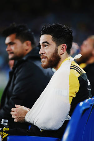 Nehe Milner-Skudder of the Hurricanes sits on the bench injured on March 11, 2016 in Auckland, New Zealand.