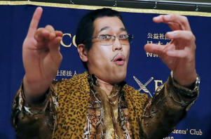 "Japanese comedian Pikotaro performs ""pen-pineapple-apple-pen"" song at a press conference in Tokyo, Friday, Oct. 28, 2016. Pikotaro behind the viral hit ""PPAP"" said he is astonished by the global success song. (AP Photo/Eugene Hoshiko)"