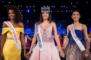 First runner up Miss Dominican Republic Yaritza Miguelina Reyes Ramirez (L); Miss World 2016 Stephanie Del Valle of Puerto Rico (C); and second runner up Miss Indonesia Natasha Mannuela (R) stand together after Del Valle's win in the Miss World 2016 page