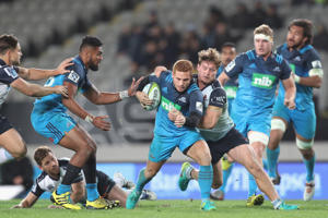 Ihaia West of the Blues is tackled during the round 17 Super Rugby match between the Blues and the Waratahs at Eden Park on July 15, 2016 in Auckland, New Zealand.