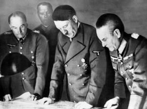 Adolf Hitler, center, confers with Field Marshal General Walther Von Brauchitsch, left, commander-in-chief of the Germany Army; and Colonel-General Franz Halder, Chief of the German Army staff, in Berlin on Aug. 7, 1941.