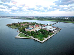Aerial photograph of Ellis Island in Upper New York Bay, Jersey City, New Jersey.  A small portion of the Island is in New York City.