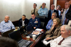 President Barack Obama and Vice President Joe Biden, along with with members of the national security team, receive an update on the mission against Osama bin Laden in the Situation Room of the White House in Washington, D.C., May 1, 2011. Seated, from left, are: Brigadier General Marshall B. 'Brad' Webb, Assistant Commanding General, Joint Special Operations Command; Deputy National Security Advisor Denis McDonough; Secretary of State Hillary Rodham Clinton; and Secretary of Defense Robert Gates. Standing, from left, are: Admiral Mike Mullen, Chairman of the Joint Chiefs of Staff; National Security Advisor Tom Donilon; Chief of Staff Bill Daley; Tony Binken, National Security Advisor to the Vice President; Audrey Tomason Director for Counterterrorism; John Brennan, Assistant to the President for Homeland Security and Counterterrorism; and Director of National Intelligence James Clapper. Please note: a classified document seen in this photograph has been obscured. (Pete Souza/The White House/MCT via...