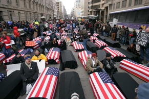 Anti-War Network (DAWN) demonstrators carry mock coffins draped with the US flag as they arrive in downtown Washington DC for the inauguration of US President George W. Bush. (Photo by Brooks Kraft LLC/Corbis via Getty Images)