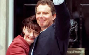 Tony and Cherie Blair embrace in front of 10 Downing Street after he was elected PM in 1997 CREDIT:  FIONA HANSON/PA