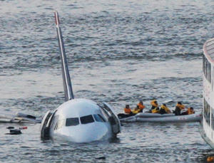 Passengers in an inflatable raft move away from an Airbus 320 US Airways aircraft that went down in the Hudson River in New York, on Jan. 15, 2009. Eight years after the miracle landing on the Hudson River, thousands of birds have been killed at New York City airports to avoid more strikes. But the slaughter has come at great expense and included many smaller species experts say are unlikely to cause a disaster.