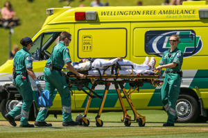 Mushfiqur Rahim of Bangladesh is stretchered into an ambulance after being struck in the helmet by a delivery from Tim Southee of New Zealand during day five of the First Test match between New Zealand and Bangladesh at Basin Reserve.