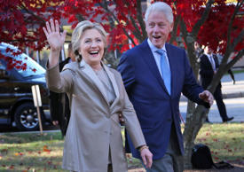 In this Nov. 8, 2016 file photo, Hillary Clinton and her husband, former President Bill Clinton, greet supporters after voting in Chappaqua, N.Y.