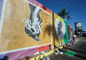 Artwork and signatures cover a fence around the Pulse nightclub, scene of a mass...