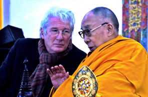 Tibetan spiritual leader the Dalai Lama speaks with Hollywood actor Richard Gere on the closing day of the Kalachakra in Bodhgaya, India, Saturday, Jan. 14, 2017. Buddhist devotees from across the globe gathered in this small town to attend the 'Kalachakra' or Wheel of Time initiations by the Dalai Lama. (AP Photo/Manish Bhandari)