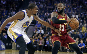 Golden State Warriors' Kevin Durant, left, defends against Cleveland Cavaliers' LeBron James during the first half of an NBA basketball game, Monday, Jan. 16, 2017, in Oakland, Calif.