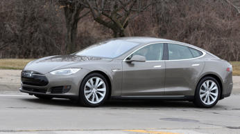 In this Tuesday, April 7, 2015 photo, a Tesla Model S 70-D electric car is test driven in Detroit.
