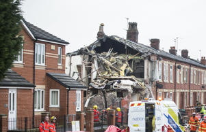 Emergency services at the scene of a house explosion on Cecil Road in Blackley, Manchester
