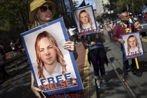 People hold signs calling for the release of imprisoned wikileaks whistleblower ...