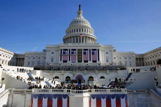 Slide 1 of 20: The U.S. Capitol looms over a stage during a rehearsal of President-elect Donald Trump's swearing-in ceremony, Sunday, Jan. 15, 2017, in Washington.