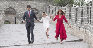 Canadian Prime Minister Justin Trudeau and Sophie Gregoire hold Ella-Grace's hand as she jumps over a drainage pipe as they visit a section of the Great Wall of China, in Beijing on Thursday, September 1, 2016.