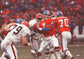 Broncos quarterback John Elway prepares to send the ball downfield en route to a...
