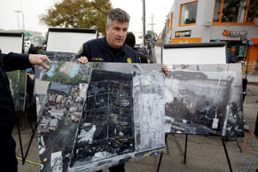 Alameda County Sheriff J.D. Nelson holds an aerial picture of a warehouse fire n...