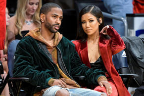Big Sean (left) and Jhene Aiko attend a game between the Jazz and the Lakers at ...