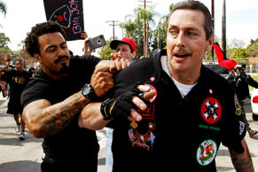 William Hagen, right, shown at a Ku Klux Klan rally in Anaheim, Calif., in February 2016, was arrested and charged with attempted murder in North Carolina while attempting to attend a Klan rally in support of President-elect Donald Trump.