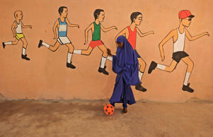 A school pupil kicks a ball during a sports lesson at a school in Mogadishu on T...