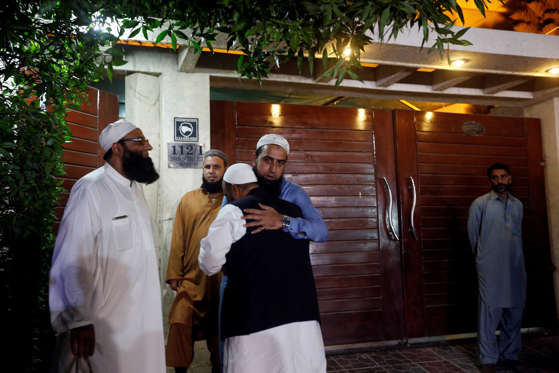 Relatives gather outside the residence of Junaid Jamshed, pop star turned evangelical Muslim cleric, in Karachi, Pakistan December 7, 2016.