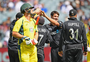 Colin de Grandhomme of New Zealand is congratulated by team mates after getting the wicket of Mitch Marsh.