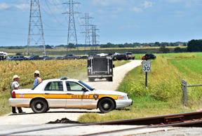 Authorities head down a dirt road toward to investigate the scene of a hot air balloon crash that left 16 feared dead near Maxwell, Texas, U.S. July 30, 2016.