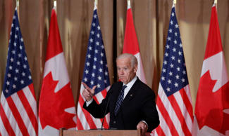 U.S. Vice President Joe Biden speaks during an official dinner at the Sir John A. MacDonald Building in Ottawa, Dec. 8, 2016.
