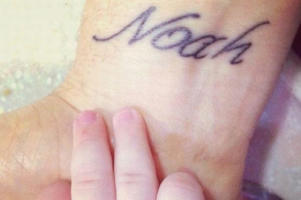 Michael Buble and wife Luisana's eldest son Noah when he was tiny - with the singer's tattoo
