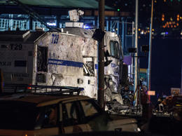 Damaged police vehicles and cars are pictured on December 10, 2016 on the site w...