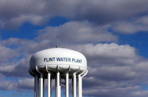 In this March 21, 2016 file photo, the Flint Water Plant water tower is seen in Flint, Mich.