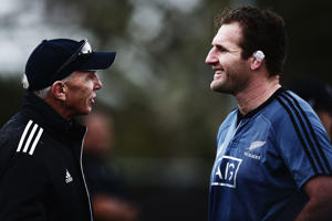 New Zealand rugby sevens coach Sir Gordon Tietjens talks to Kieran Read following a New Zealand All Blacks training session on June 17, 2014 in Hamilton, New Zealand.