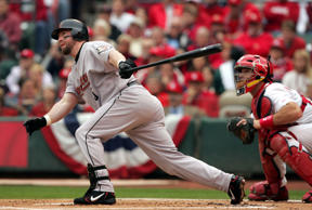 ST. LOUIS - OCTOBER 20:  Jeff Bagwell #5 of the Houston Astros hits a single in the first inning of Game 6 of the National League Championship Series against the St. Louis Cardinals October 20, 2004 at Busch Stadium in St. Louis, Missouri.  (Photo By Ste