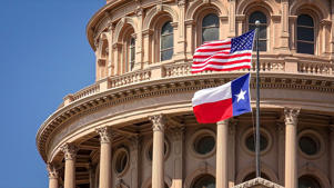 In this file photo, American and Texas state flags fly on the dome of the Texas State Capitol building in Austin.