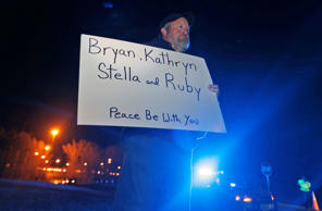 Staunton Va., resident, Chuck Troutman, holds a sign in remembrance of the Harvey family outside the Greensville Correctional Center in Jarratt, Va., Wednesday, Jan. 18, 2017.